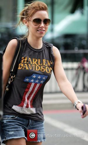Una Healy departs a record company office in west London wearing a Harley Davidson T-shirt London, England - 06.08.10