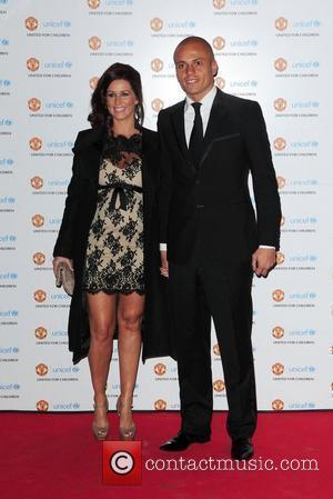 Wes Brown and his wife  UNICEF Dinner 2010 held at Manchester United Football Club, Old Trafford Manchester, England -...