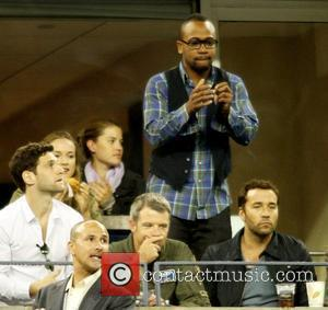 Columbus Short and Jeremy Piven Celebrities watch the men's finals match on Day 15 of the 2010 US Open in...