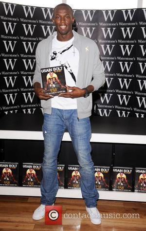 Usain Bolt signs copies of his book '9.58' at Waterstone's Piccadilly. London, England - 02.09.10