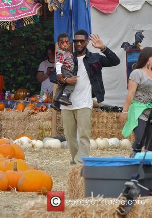 R&B singer Usher Raymond celebrated his birthday to take his son, Usher Raymond V to the Mr. Bones Pumpkin Patch...