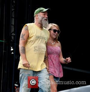 Seasick Steve Picked Out A Young Girl From The Audience To Sing Her A Song Called 'walkin' Man'