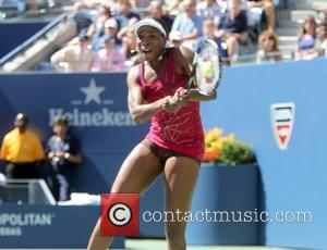 Venus Williams defeats Shaher Peer of Israel  7-6(3), 6-3, during her women's singles match on day seven of the...