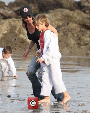 Victoria Beckham and Romeo Beckham running on the beach Malibu, USA - 31.01.10