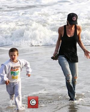 Victoria Beckham and Cruz Beckham running the beach and getting their feet wet Malibu, USA - 31.01.10