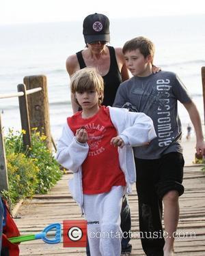 Victoria Beckham, Brooklyn Beckham and Romeo Beckham walking back from beach Malibu, USA - 31.01.10