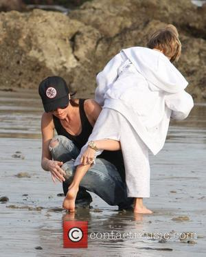 Victoria Beckham and Romeo Beckham playing on the beach Malibu, USA - 31.01.10