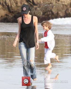 Victoria Beckham and Romeo Beckham walking on the beach Malibu, USA - 31.01.10