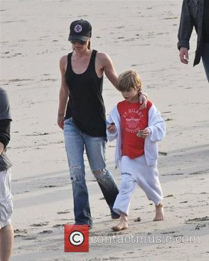 Victoria Beckham and Romeo Beckham playing walking the beach Malibu, USA - 31.01.10