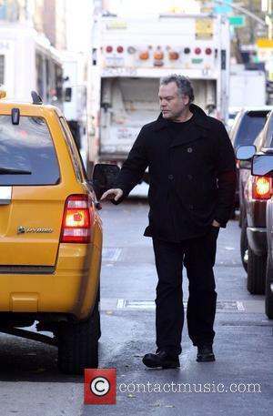 Vincent D'Onofrio walks onto the street to hail a cab while out and about in SoHo New York City, USA...
