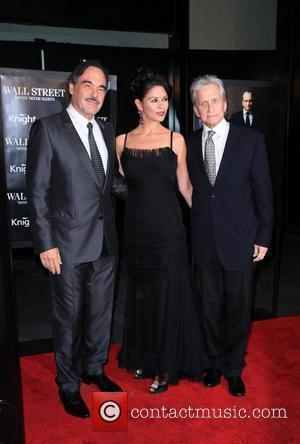 Oliver Stone, Catherine Zeta Jones, Michael Douglas and Wall Street