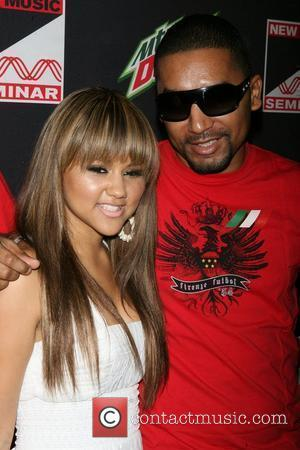 Kat DeLuna, DJ Mad ,  at the opening night party for the 2010 New Music Seminar at The Revolution...