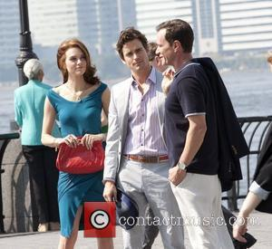 Hilarie Burton, Matt Bomer and Tim DeKay on location filming a scene for their TV show 'White Collar' at Battery...