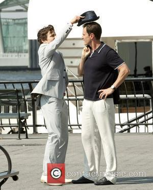 Matt Bomer and Tim DeKay on location filming a scene for their TV show 'White Collar' at Battery Park...