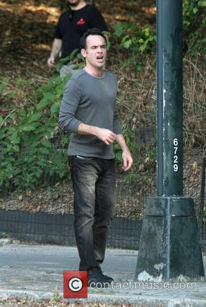 Paul Blackthorne on location filming a scene for their TV show 'White Collar' at Battery Park in Central Park New...