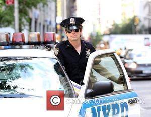 Matt Bomer  Matt Bomer and Willie Garson filming 'White Collar' on location in New York City.  New York,...