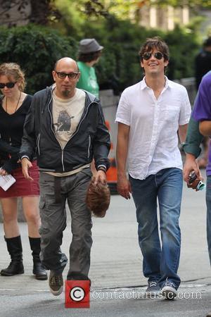 Matt Bomer, Willie Garson Matt Bomer and Willie Garson filming for the US hit series 'White Collar' on location in...