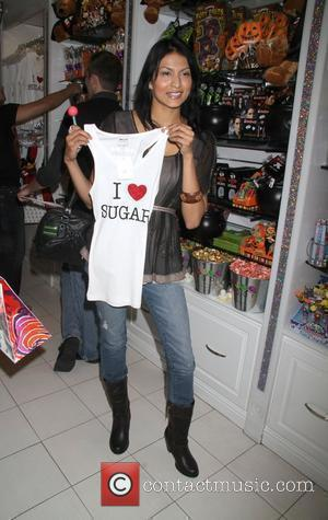 Tinsel Korey The Twilight Wolf Pack bite into something sweet at Sugar Factory at Miracle Mile shops at Planet Hollywood...