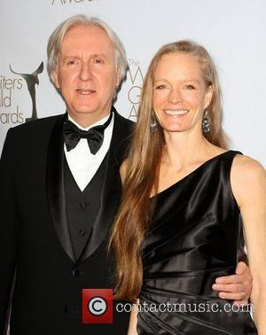 James Cameron and his wife Suzy Amis The 2010 Writers Guild Awards held at The Hyatt Regency Century Plaza -...