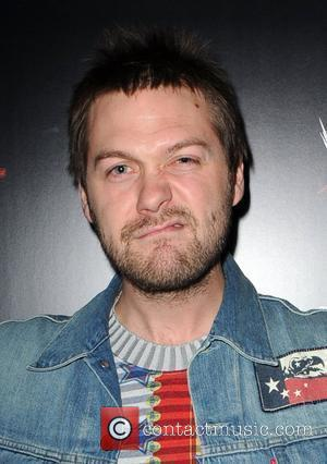 Tom Meighan, lead singer of Kasabian The Wrestlemania Revenge Tour party at the American bar and Grill at the O2...