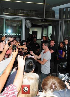 Scherzinger Shamed By Cowell Prank