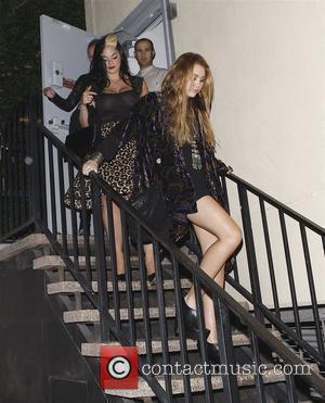 Miley Cyrus at the opening of Xandros Greek Restaurant at 50 N. La Cienega Blvd Beverly Hills, California - 07.10.10