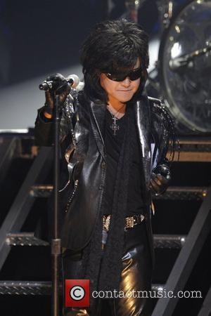 Toshimitsu 'Toshi' Deyama  of 'X Japan' performing on stage at Massey Hall.   Toronto, Canada - 07.10.10