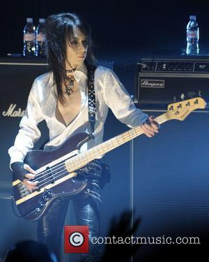 Hiroshi 'Heath' Morie   of 'X Japan' performing on stage at Massey Hall.   Toronto, Canada - 07.10.10