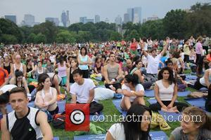The 'yoga at the great lawn' event in Central Park New York City, USA - 22.06.10