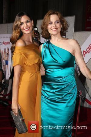 Odette Yustman and Sigourney Weaver Los Angeles Premiere of You Again held at the El Capitan Theatre Hollywood, California -...