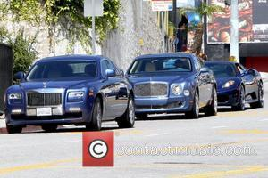 50 Cent aka Curtis James Jackson III arrives at an office building with his entourage for a meeting. Before entering...