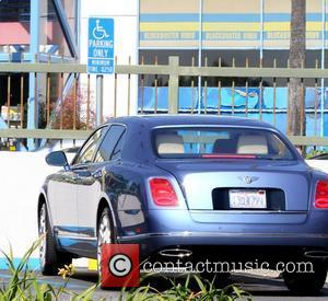 50 Cent aka Curtis James Jackson III's Bentley parked in a handicap spot, where he arrived with an entourage to...
