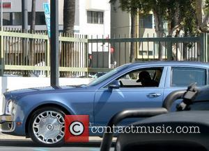 50 Cent aka Curtis James Jackson III's Bentley parked in a handicap parking spot outside an office building, which the...