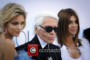 Karl Largerfeld with Carine Roitfeld, editor of French Vogue 2011 Cannes International Film Festival - Day 9 amFar Cinema against...
