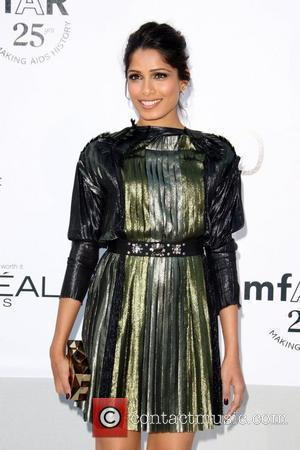 Freida Pinto 2011 Cannes International Film Festival - Day 9 amFar Cinema against Aids gala - Arrivals Cap d'Antibes, France...