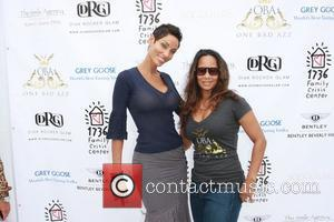 Nicole Murphy and guest  Bella Fortuna Gifting Suite - A Day Of Giving And Receiving at the Luxe Hotel...