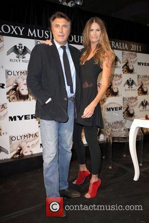 Bryan Ferry Signs copies of his new album 'Olympia' with special guest Elle Macpherson at the Myer department store Sydney,...