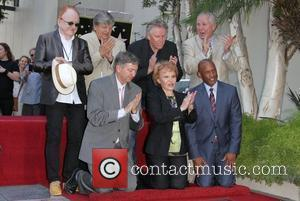 Peter Asher, Phil Everly, Maria Elena Holly and Gary Busey, Tom Lebonge and Leroy Gruber Buddy Holly Star Unveiling On...