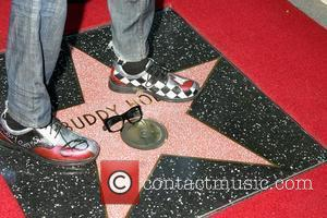 Buddy Holly Star, with Gary Busey's feet and glasses Buddy Holly Star Unveiling On The Hollywood Walk Of Fame Held...