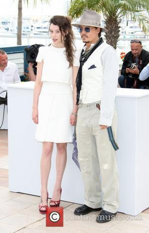 Astrid Berges-frisbey and Johnny Depp