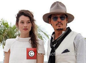 Astrid Berges-Frisbey and Johnny Depp 2011 Cannes International Film Festival - Day 4 - Pirates of the Caribbean: On Stranger...
