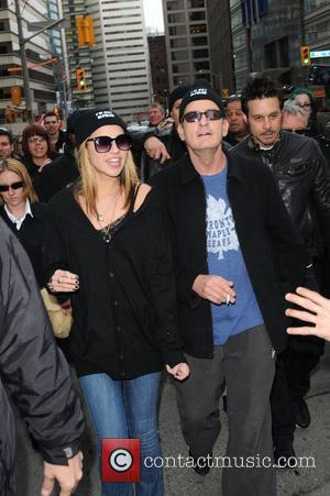 Charlie Sheen and his goddess Natalie Kenly leave his hotel and walk to Massey Hall as part of his...