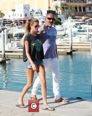 Christian Audigier and his girlfriend Nathalie Sorensen take a walk in the Cabo San Lucas Marina while spending a romantic...