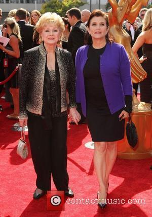 Debbie Reynolds, Carrie Fisher 2011 Primetime Creative Arts Emmy Awards Held at The Nokia Theatre L.A. Live Los Angeles, California...