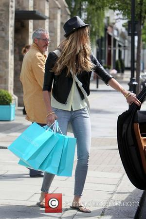 Elle Macpherson returns to her car after shopping in the West End London, England - 01.06.11