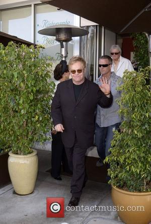 Elton John leaves E Baldi restaurant after lunch. He appeared in good spirits and waved to the photographers Beverly Hills,...