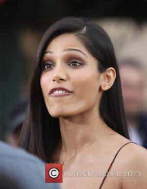 Freida Pinto appears on Extra at the Grove Hollywood, California - 09.11.11