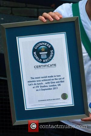 Gino D'Acampo  shows off his Guinness world record certificate for making ravioli London, England - 02.09.11
