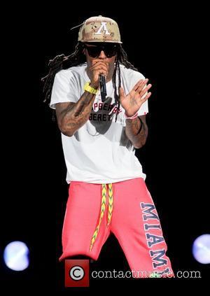 Lil' Wayne performs during the I am Still Music Tour at the Cruzan Amphitheatre  West Palm Beach , Florida...