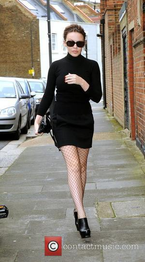 Kylie Minogue arriving at an office wearing a black outfit with fishnets London, England - 27.10.11